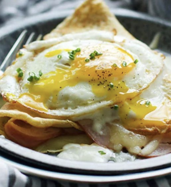 sliced ham & swiss or pepper jack cheese nestled in a hot crepe, topped with a sunny-side up egg